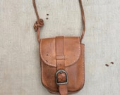 vintage ca. 1980s distressed mini leather crossbody / belt bag with adjustable strap