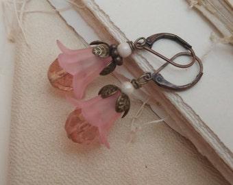 Pastel pink pearl flower earrings.