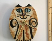 wall clock: cat oval blue eyed white black rust feline design ceramic hand made whimsical animal pet resort vetinary decor