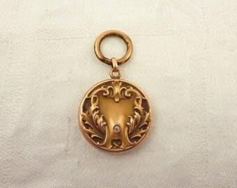 Antique Victorian 14K Gold Rococo Flourish Locket with Old Mine Cute Diamond