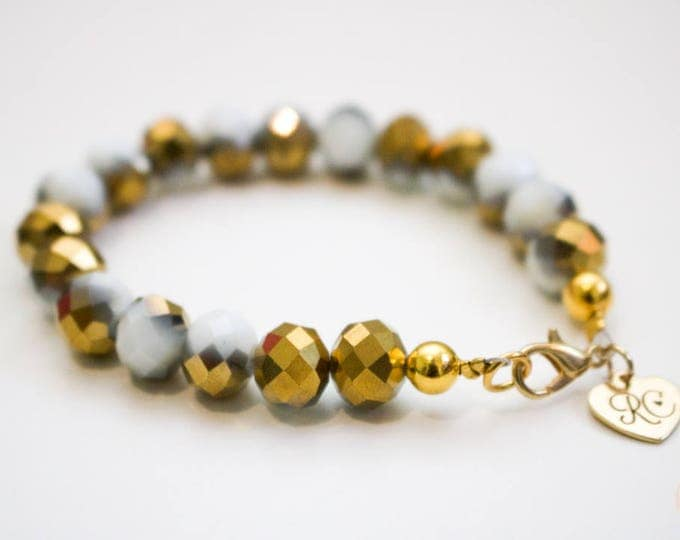 RC Signature Bracelet in Gold and White Lustre.