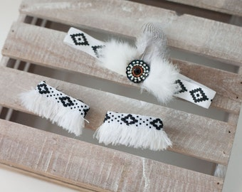 american indian inspired fur wrist ankle cuff set with feather headband in black and white tribal print