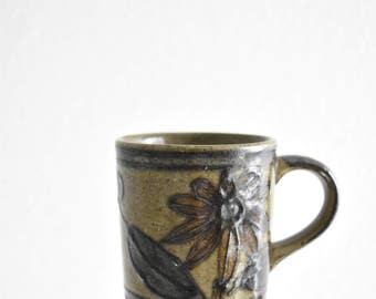 vintage glazed earth tone brown stoneware coffee mug / flower flora / pottery