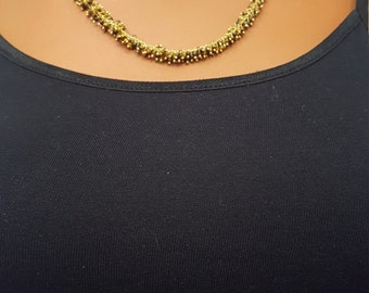 Gold chain with wire wrap dangling caramel and black beads