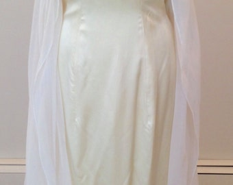 An Elegant sheath styled wedding dress by Carmela Sutera size 6