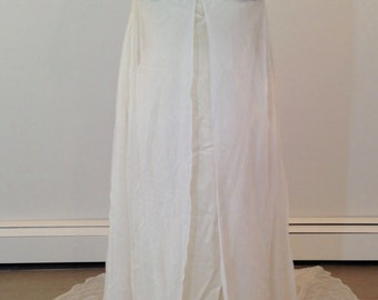 A Stunning Sheath Dress by designer Carmela Sutera size 4