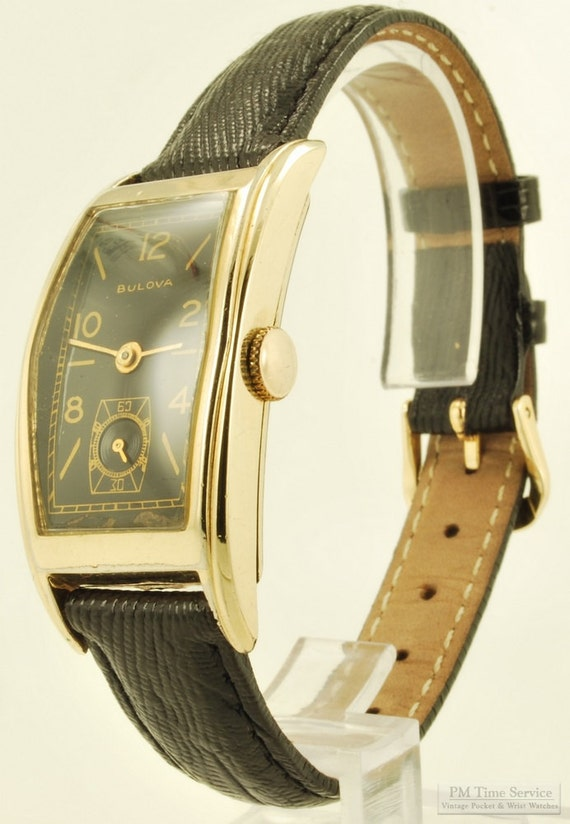 Bulova vintage grade 7AP wrist watch, 17 Jewels, long rectangular yellow gold filled smooth polish Bulova case