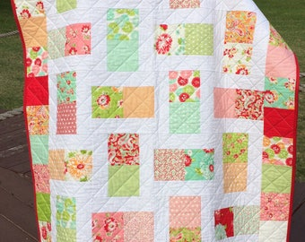 "A Color Block Quilt Of Red, Aqua, Pink And More, In This 45"" X 54"" Quilt In The Line Called Scrumptious For Moda By Bonnie & Camille"