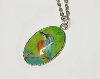Kingfisher necklace: tiny brightly coloured painting of a Kingfisher bird, in a silver oval glass topped  pendant
