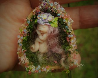 sweet tiny minature ooak  fairy fairie in half faux walnut shell necklace one inch fairy