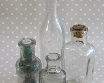 Vintage Set of 4 Small Clear Glass Round Rectangle Medicine Bottles of Different Size one with a Cork