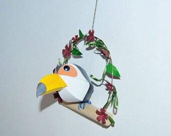 baby toucan on a floral swing, paper sculpture bird, handmade sculpture,