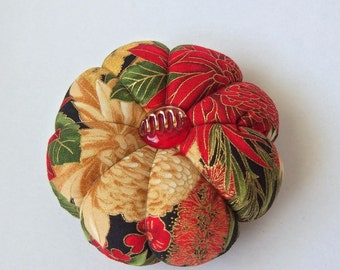 Pincushion Native Flowers Fabric . Great for a sewing gift - Round Pin cushion. Australian floral fabric with gold accents. pins holder