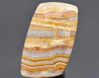 Banded Travertine Cabochon from New Mexico 59.80 cts.