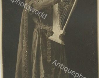 Handsome actor with harp antique photo