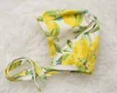 lemon print pilot hat by Little Lapsi. Baby hat with ties.