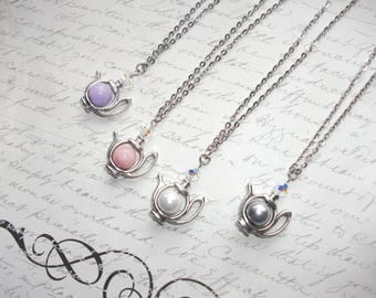 Teapot pendant necklace with pearl and crystal