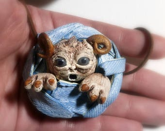 Clay monster necklace polymer clay horned creature in denim rag ball dark brown faux suede cord sliding knots adjustable length