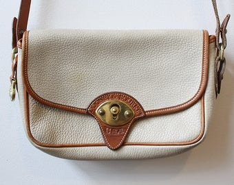 Vintage Authentic Dooney and Bourke Small White and Tan Pebbled Leather Cavalry Bag, Cross Body