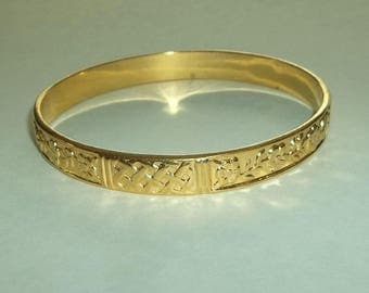 Gold tone Bangle  woven with raised Flowers