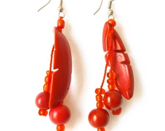 Scarlet bright red nutshell earrings with acai seeds, carved leaf design. Hand made in Brazil.