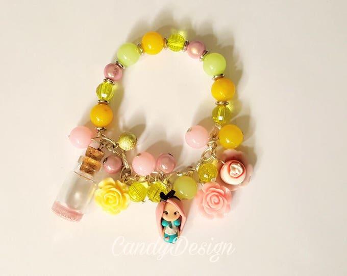 Alice in wonderland, inspired bracelet with pendants. Adjustable bracelet. Clay charm. Eat me cookie.Disney jewelry. Alice jewels