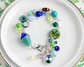 Quirky Nook: Ocean Blue Green Multi-Strand Beaded Charm Bracelet with 12mm Peridot Double AB Swarovski Crystal, Charm Bracelet, Bracelet