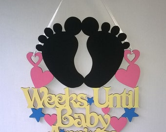 Weeks until baby arrives, baby countdown, baby shower, gender reveal, pregnancy announcement, baby feet, bun in the oven, pregnancy reveal