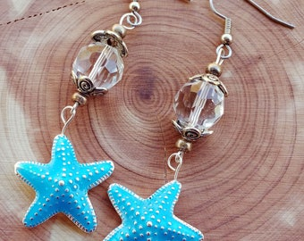 Bright blue starfish earrings with large clear swarovski crystal and silver flower bead caps