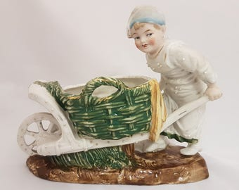 Vintage Planter Or Vase ~ Part Glazed Bisque Figurine Of A Boy Pushing A Cart ~ Barrow Boy 7.5 Inches Long
