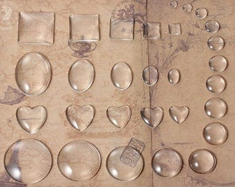 29 cabochons in glass shapes and sizes