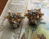 Vintage signed Robert seed pearl and rhinestones gold tone clip on earrings.