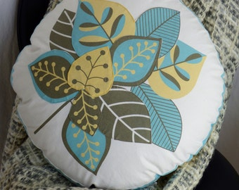 "Round 20"" diameter cushion pillow cover has appliquéd leaf pattern on front, stripes on side & reverse. Yellow, white, turquoise, grey/brown"