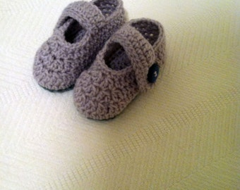 Baby gray  shoes with 2 buttons.