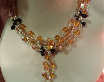 Two strand gold brown, black vintage crystal long necklace with tassel drops and decorative clasp and matching earrings