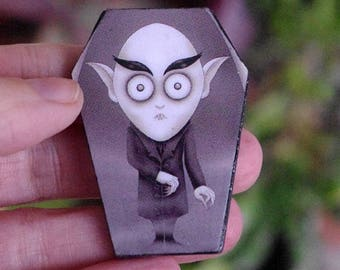 Nosferatu pin. Coffin shape wooden brooch Count Orlok illustration.  Horror film brooch. Murnau film.