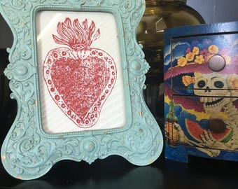 Beautiful authentic Mexican Sacred Heart in an Antiqued Seafoam Green resin 4x6 frame. Red Sacred Heart printed on fiber paper.
