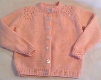 Soft Pink Toddler Cardigan with Smocked Detail and Pearlized Buttons