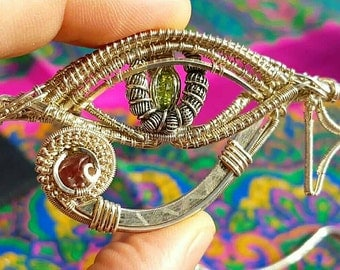 Eye of Horus wire wrapped pendant