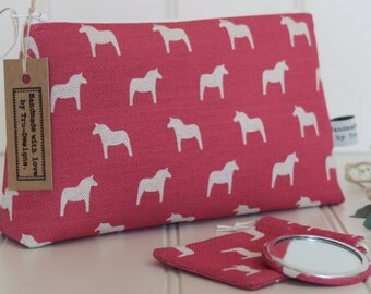 Make up bag in Olive & Daisy, Swedish Horses in Red Blotch Linen.