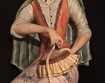 A Stunning Capodimonte Viertasca Figurine, Young Girl Sitting on Tree Stump Sewing