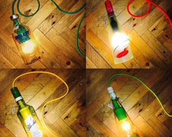 Stylish bottle lamp with coloured textile cable