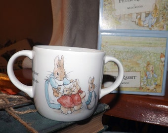 Vintage (c. 1993) Wedgwood Peter Rabbit double-handled nursery mug with original box.
