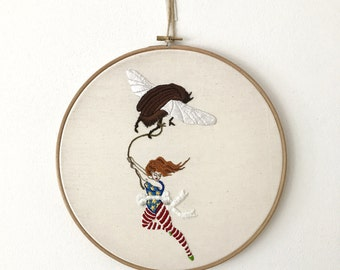 The flight of the beetle. Handmade embroidery hoop art.