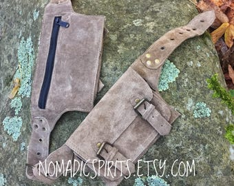 Unisex - 4 pocket festival utility belt with buckles and snap lock closures.