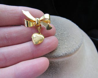Vintage Goldtone Bow Pin With Dangling Floral Etched Heart Locket