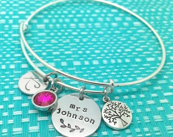 Personalised hand stamped charm bracelet featuring a crystal and tree of life charm. Teacher gift. Teacher gifts. Family gifts. Hand made.