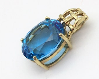 Vintage 6 Carat Oval Cut Blue Topaz Pendant in 10K Yellow Gold!