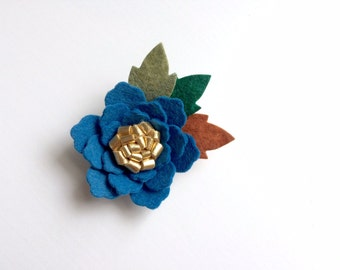 Norwiegian blue rose with gold center and green leaves - alligator clip - headband