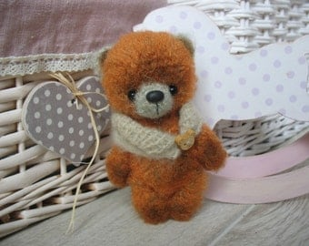 Miniature crocheted bear Ben, knitting by a hook of a bear of Teddy, knitted toys